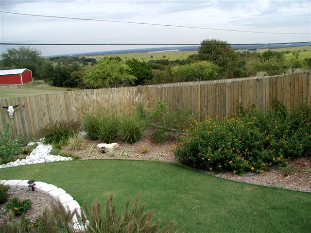 Backyard Ideas Texas random slate tile patio with curved slate border by the western patio company in spring texas western red cedar steps lead to back door with purple iris Beautiful Backyard Landscaping North Texas 11 Almost Inspiration Article